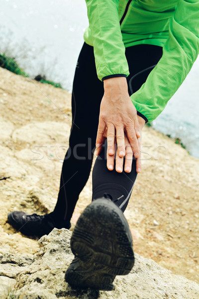 young sportsman stretching his legs Stock photo © nito