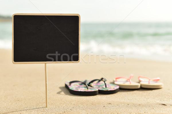 Stock fotó: Fekete · tengerpart · közelkép · kettő · homok · tenger