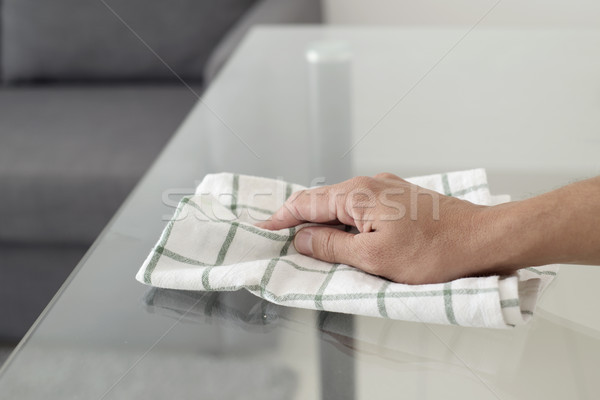 young man cleaning a glass table Stock photo © nito