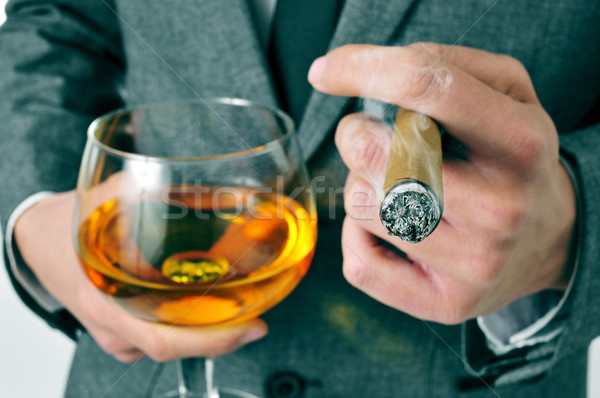 man in suit with a cigar and a glass with brandy Stock photo © nito