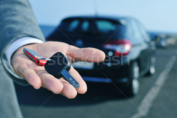 man offering a car key to the observer Stock photo © nito