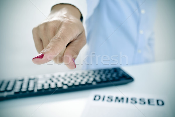 businesswoman pointing with her finger the way out Stock photo © nito