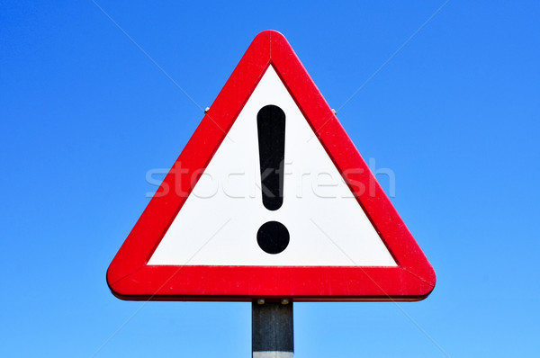 triangular traffic sign with an exclamation mark Stock photo © nito
