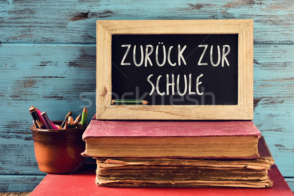 text back to school in German in a chalkboard Stock photo © nito