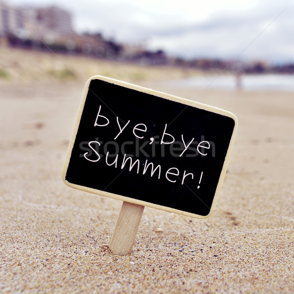 text bye, bye summer in a signboard on the beach Stock photo © nito