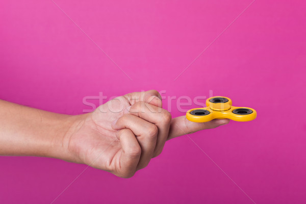 young man playing with a fidget spinner Stock photo © nito