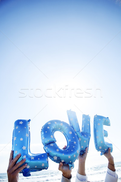 Ballonnen woord liefde handen man Stockfoto © nito