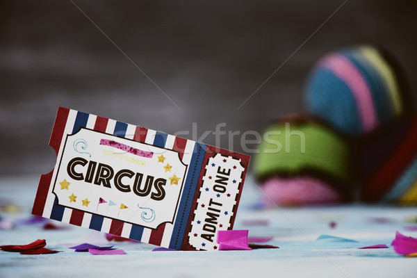 circus admission ticket and juggling balls