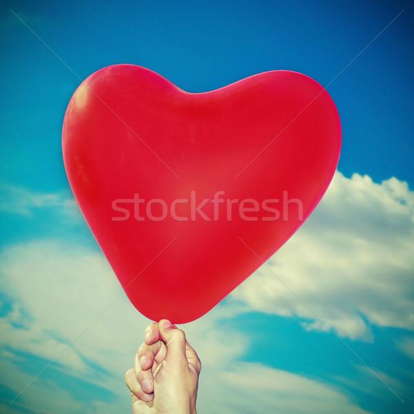Rood ballon iemand blauwe hemel wolken Stockfoto © nito