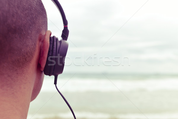 young man listening to music  in front of the sea, filtered Stock photo © nito