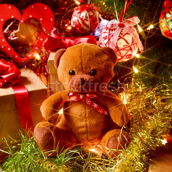 teddy bear and gifts under a christmas tree Stock photo © nito