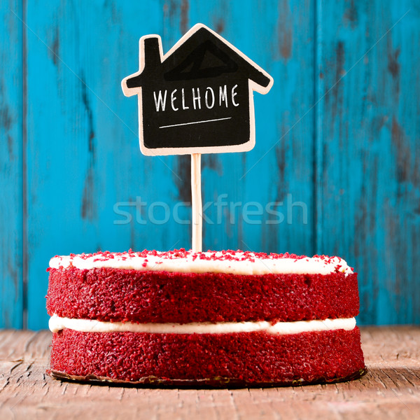 house-shaped chalkboard with the text welhome in a cake Stock photo © nito
