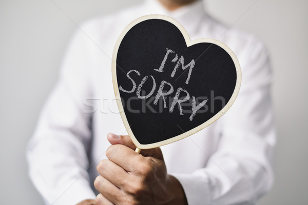 man with a signboard with the text I am sorry Stock photo © nito