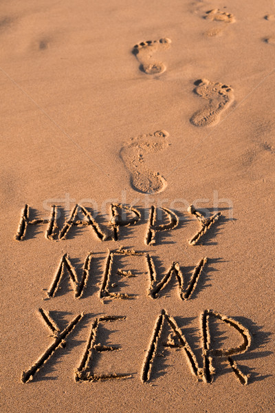 text happy new year in the sand of a beach Stock photo © nito