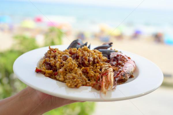 Platte charakteristisch spanisch junger Mann Meeresfrüchte Stock foto © nito