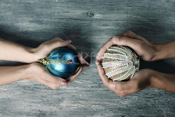 woman and man with ornamented christmas balls Stock photo © nito