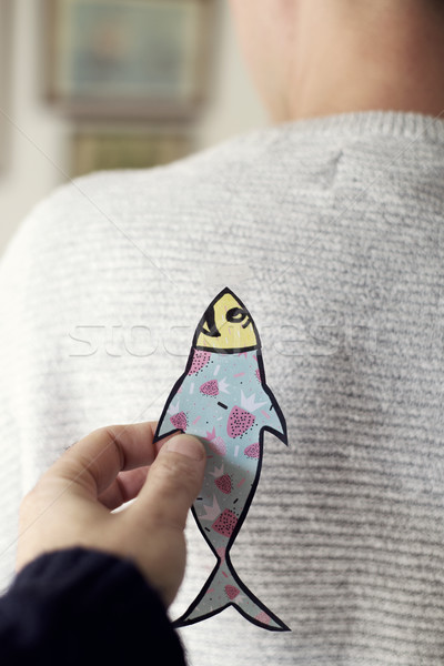 paper fish in the back of man for april fools day Stock photo © nito