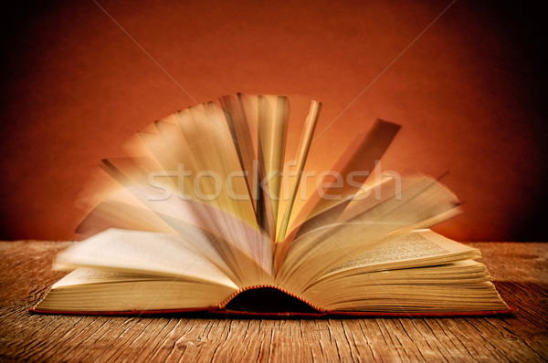 open old book on a rustic wooden table Stock photo © nito