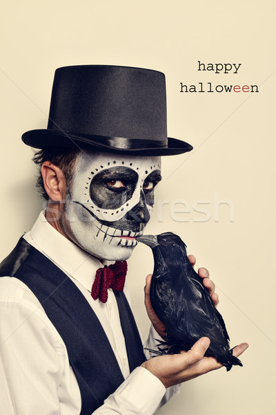 man with calaveras makeup and crow, and text happy halloween Stock photo © nito