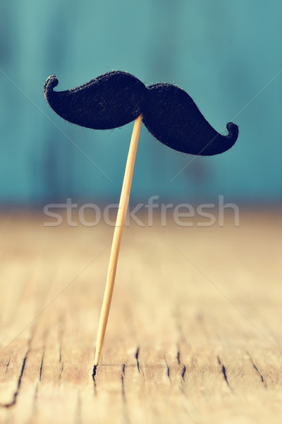 felt mustache in stick on a wooden surface Stock photo © nito
