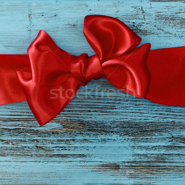 red ribbon bow on a blue wooden surface Stock photo © nito