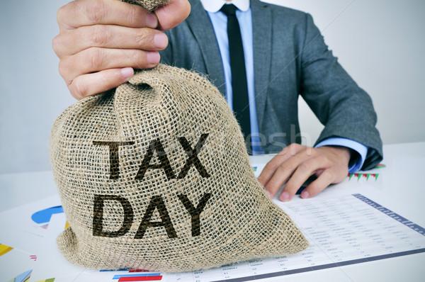 Férfi pénz táska szöveg adó nap Stock fotó © nito
