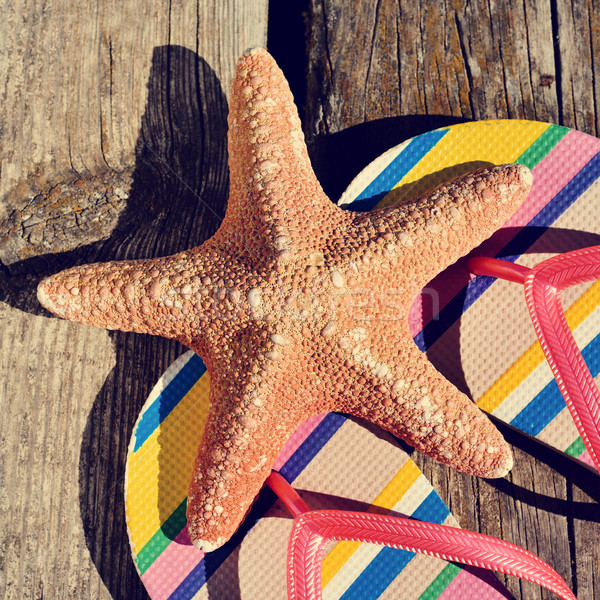 flip-flops and starfish on a wooden pier Stock photo © nito
