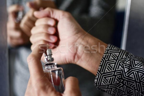 Fiatalember parfüm közelkép fiatal kaukázusi férfi Stock fotó © nito