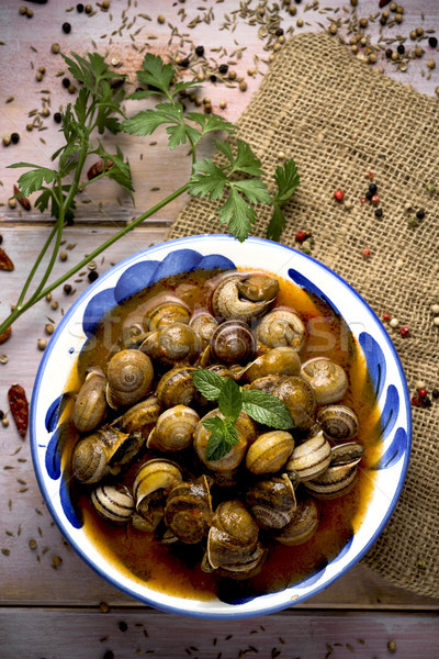 spanish caracoles en salsa, cooked snails in sauce Stock photo © nito