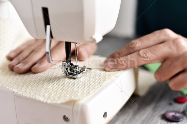 young man using a sewing machine Stock photo © nito