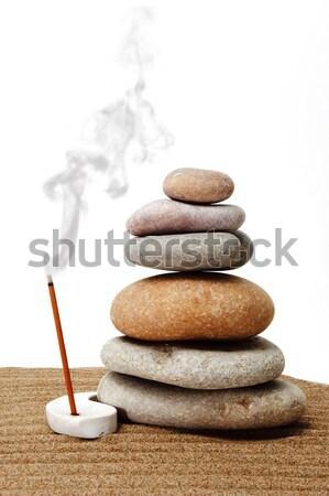 Kiegyensúlyozott zen kövek köteg fehér pihen Stock fotó © nito