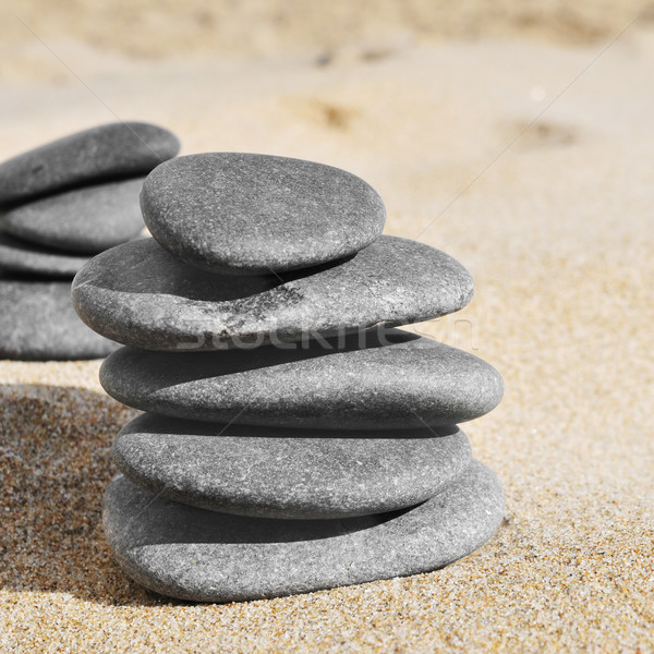 stacks of stones on the sand of a beach Stock photo © nito