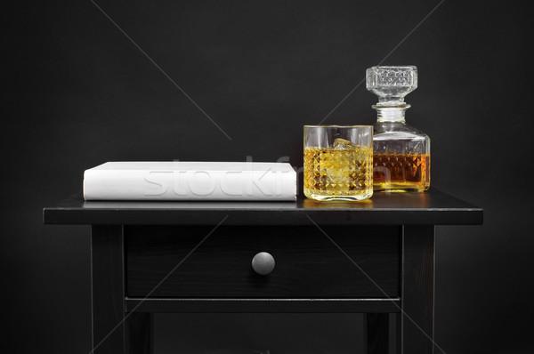 Libro botella vidrio mesa negro Foto stock © nito