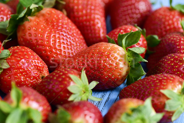 strawberries on a blue wooden surface Stock photo © nito