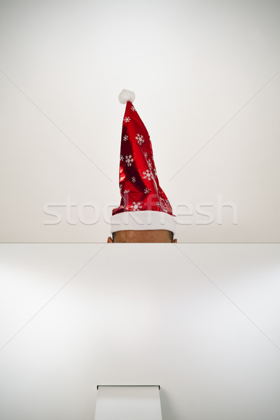 man with a santa hat in his office Stock photo © nito