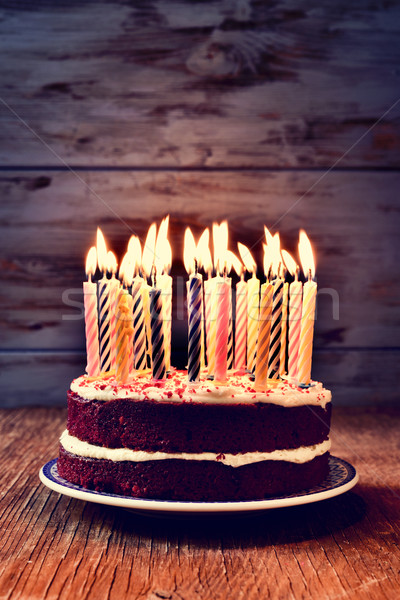 birthday cake with many lit candles Stock photo © nito