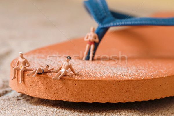miniature people in swimsuit on the beach Stock photo © nito
