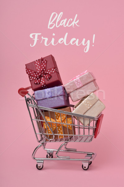 shopping cart full of gifts and text black friday Stock photo © nito
