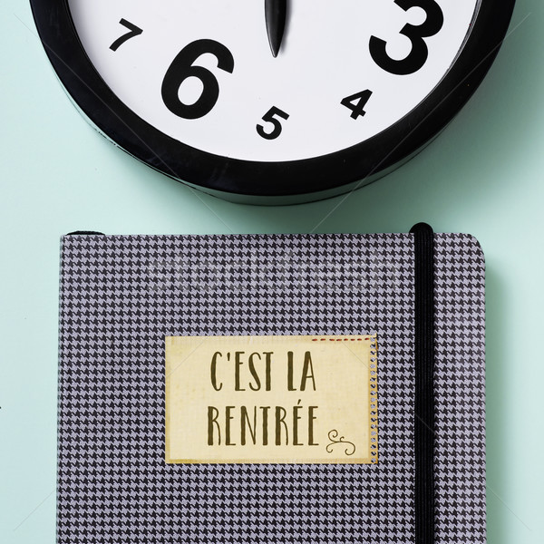 notepad, clock and text back to school in french Stock photo © nito