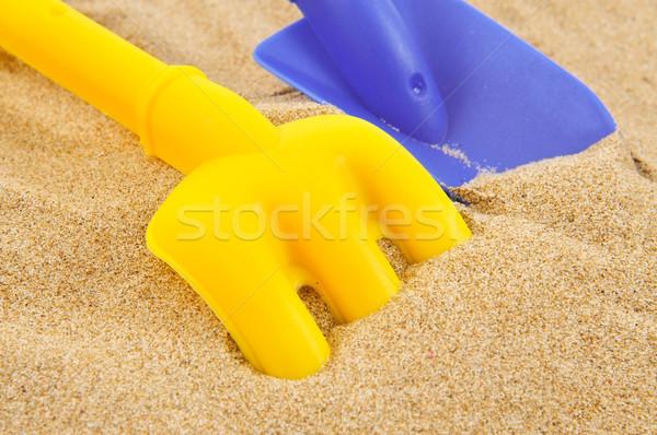 Oyuncak kürek tırmık kum mavi sarı Stok fotoğraf © nito