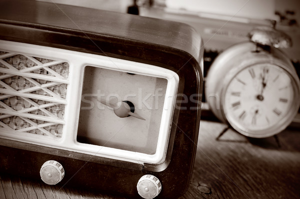antique radio, alarm clock and typewriter, in sepia toning Stock photo © nito