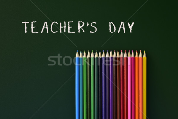 coloured pencils and text teachers day written in a green chalkb Stock photo © nito