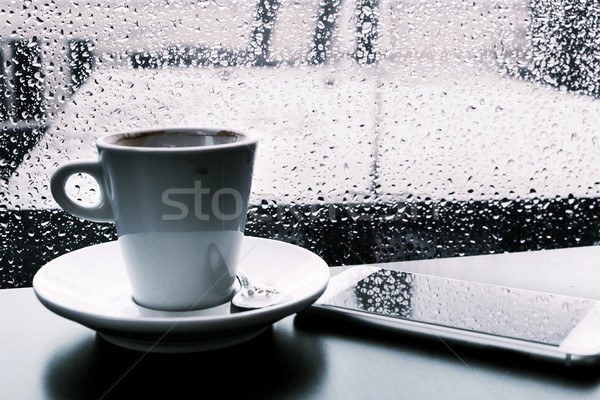 cup of coffee and smartphone on the rain Stock photo © nito