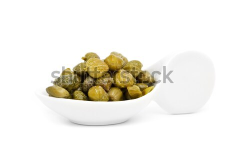 pickled capers in a porcelain spoon Stock photo © nito