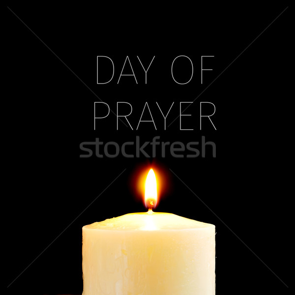 Stock photo: lit candle and text day of prayer