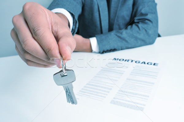 man in suit giving the keys Stock photo © nito