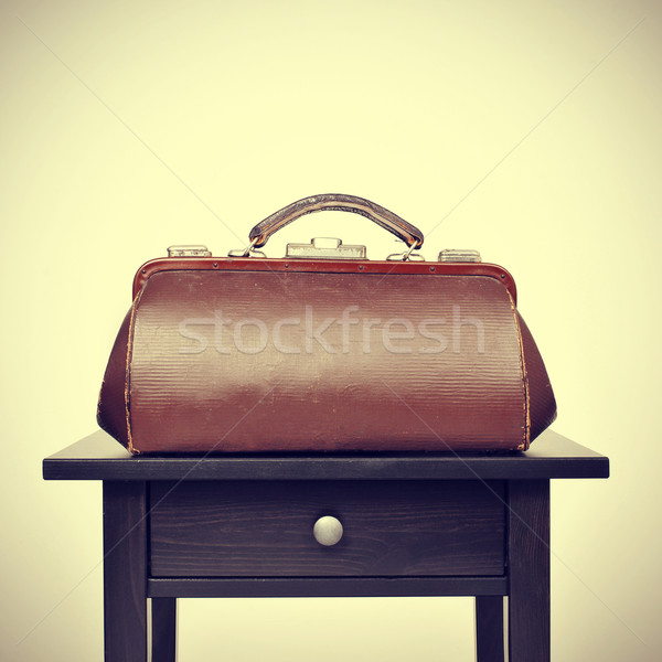 old doctors bag on a table, with a retro filter effect Stock photo © nito