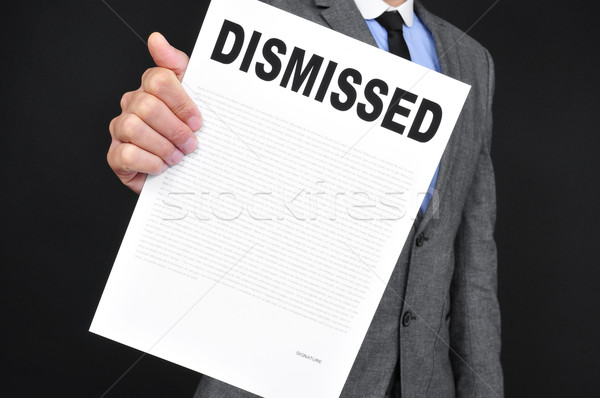man in suit showing a document with the text dismissal Stock photo © nito