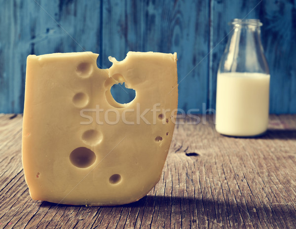 cheese and milk on a rustic wooden table Stock photo © nito