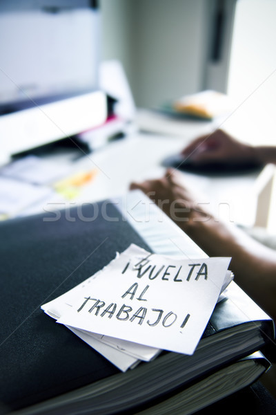 man at office and text back to work in spanish Stock photo © nito